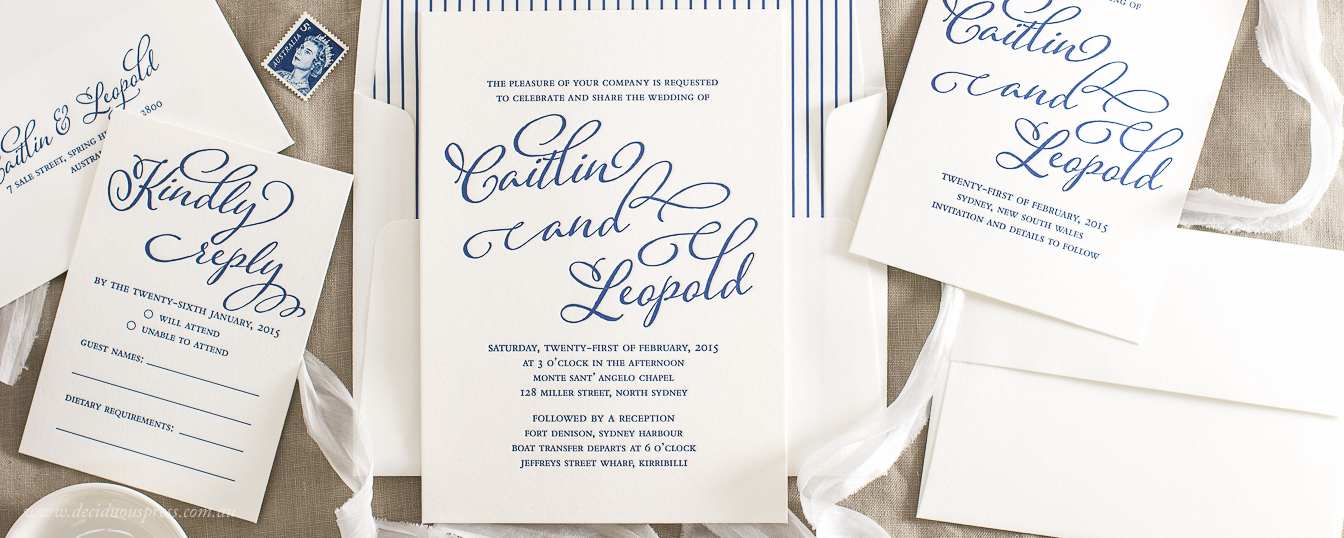 Letterpress wedding invitation in crisp navy ink