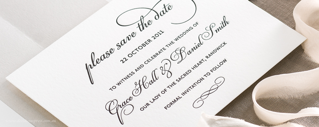 Letterpress wedding save the date card with flourished text