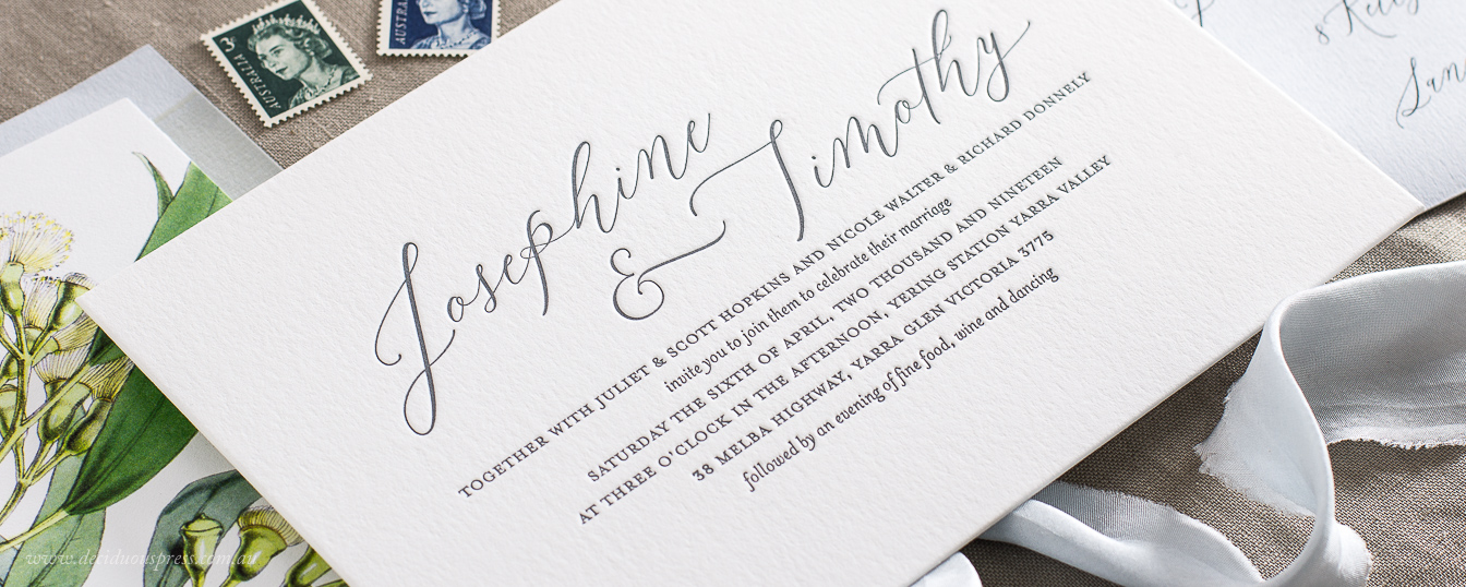 Letterpress wedding invitation detail with calligraphy