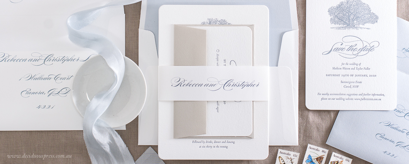 Assembled letterpress wedding invitations with name bands