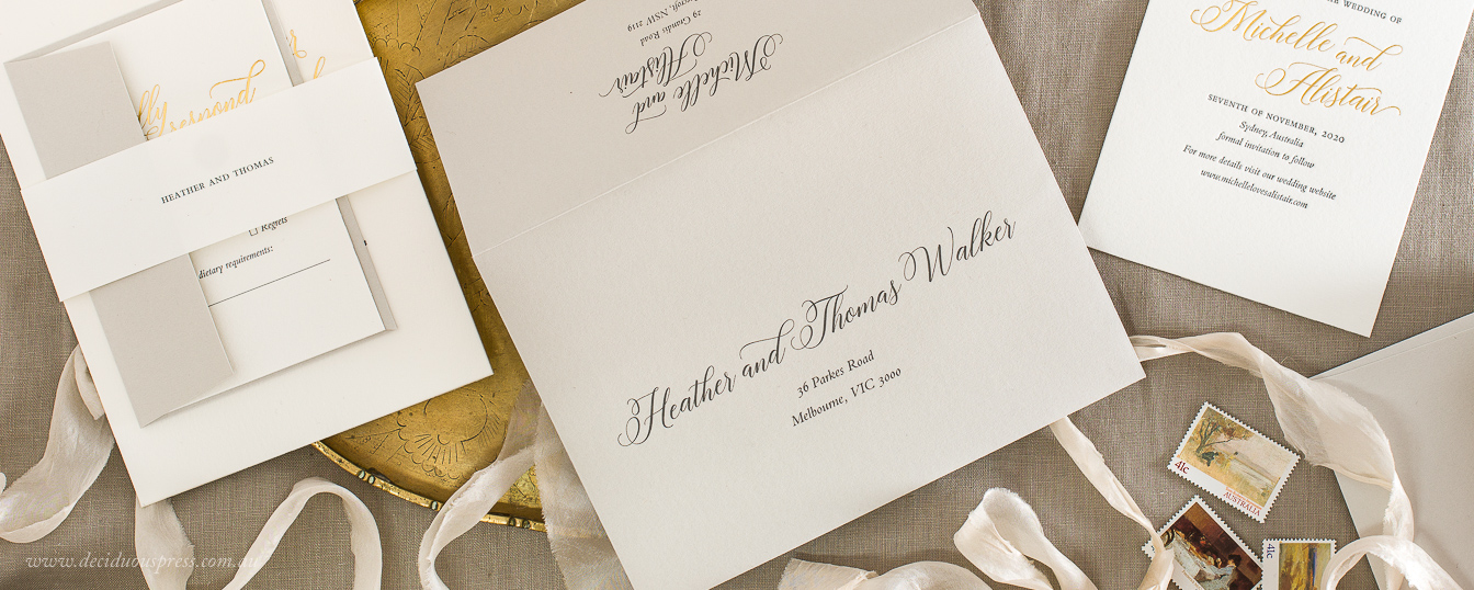 Name band paper wrap with guest names neutral colours wedding invitation